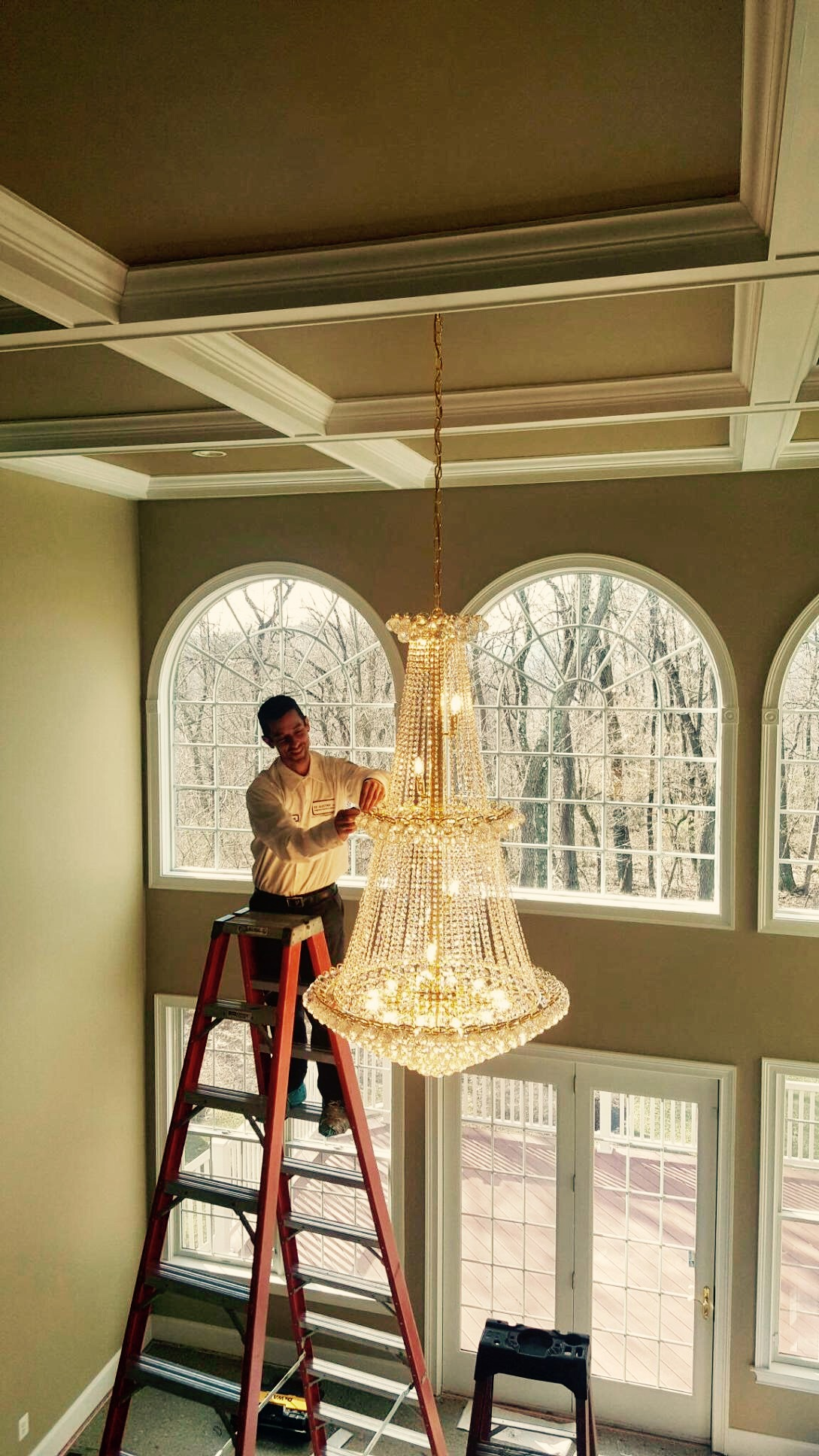 How to install a chandelier on tall ceiling musethecollective chandelier installation hiring a licensed electrician arubaitofo Choice Image