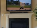 tv wall mounting over fireplace