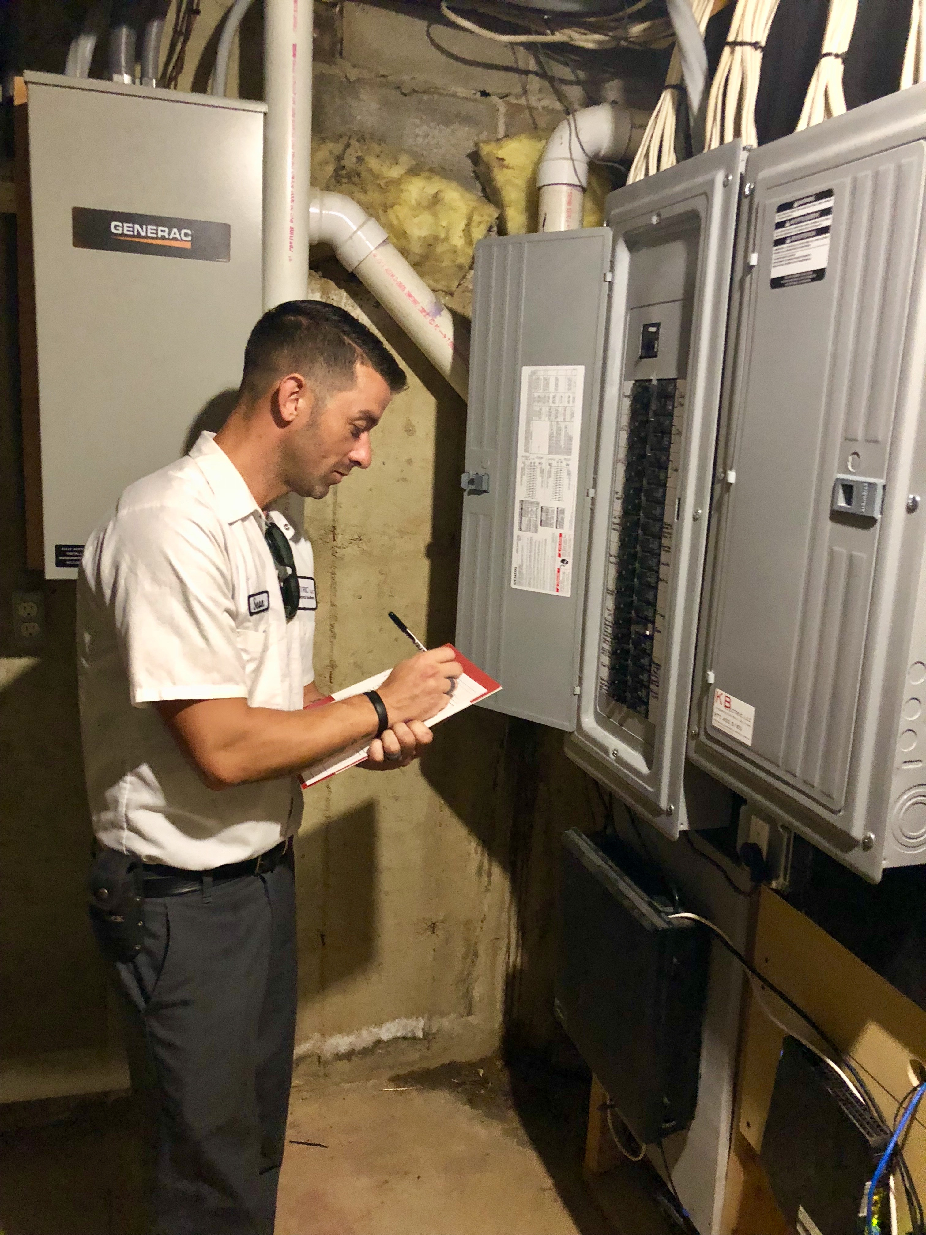 difference between an electrician and an electrical inspector: electrician performing electrical inspection for homeowner